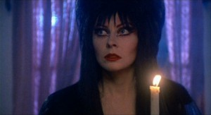 Elvira, Mistress Of The Dark   Elvira candleCR 300x163 reviews horror comedy
