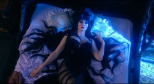 Elvira, Mistress Of The Dark   Elvira gothbedCR 300x164 reviews horror comedy