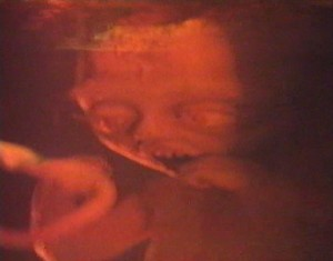 Miami Golem   Miami Golem fetus red 300x235 sci fi reviews horror action